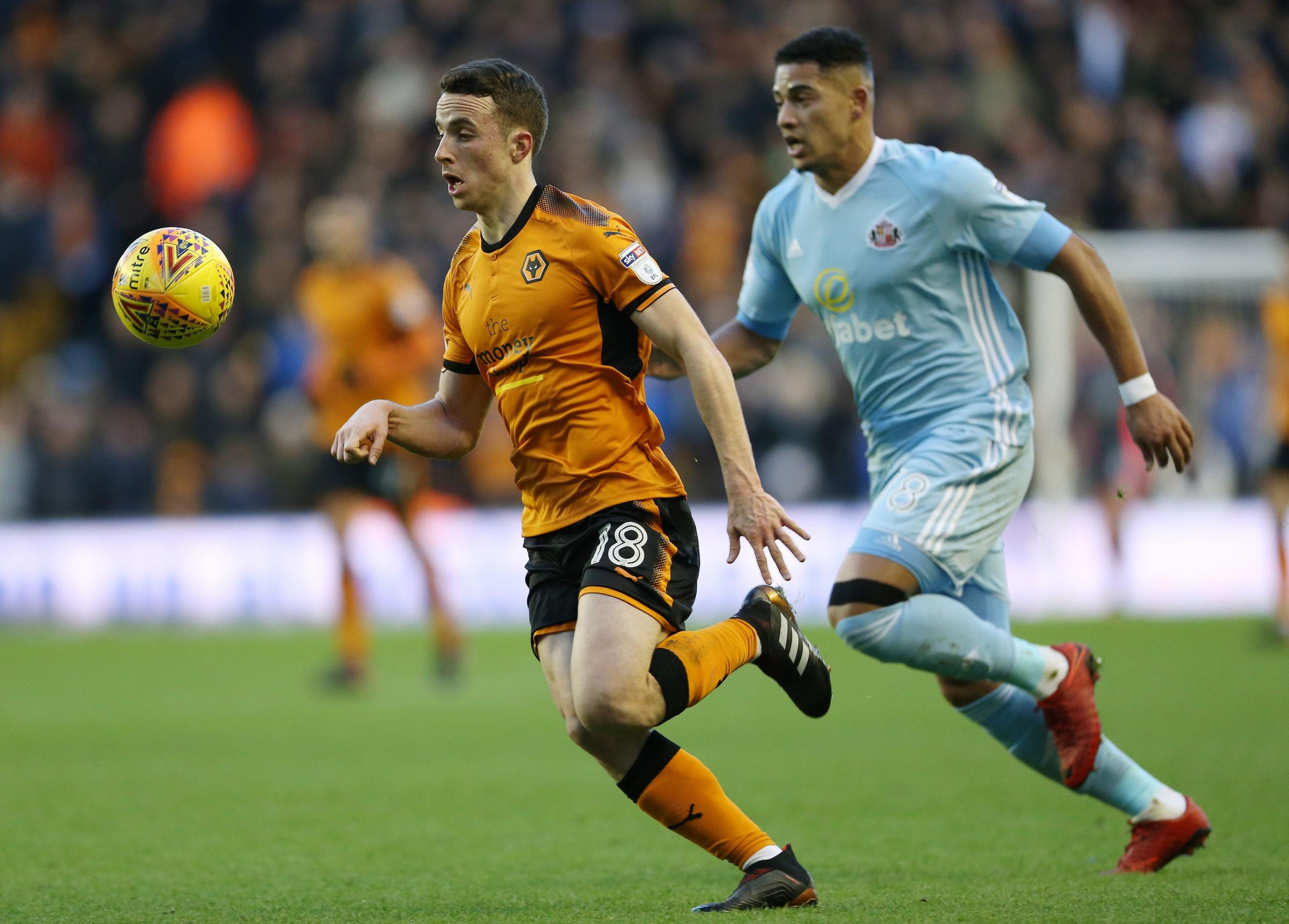 BATTLE: Ty Browning competes with Diogo for the ball at Molineux