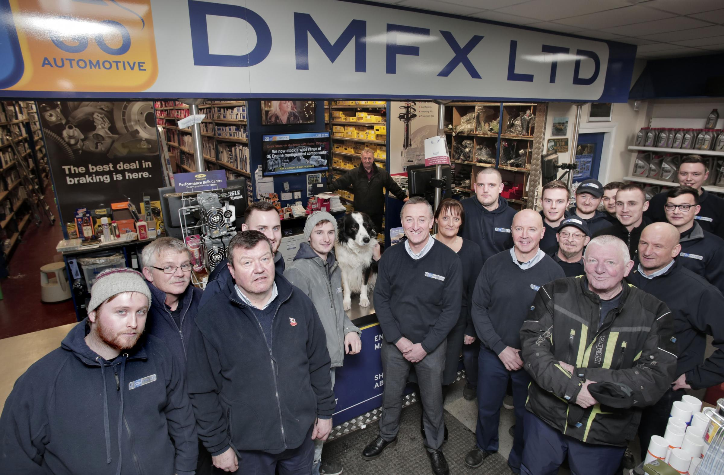 TEAM: Steve Goodfellow and Steve Henry, front centre, with staff and Marley the dog at DMFX          Picture: STUART BOULTON