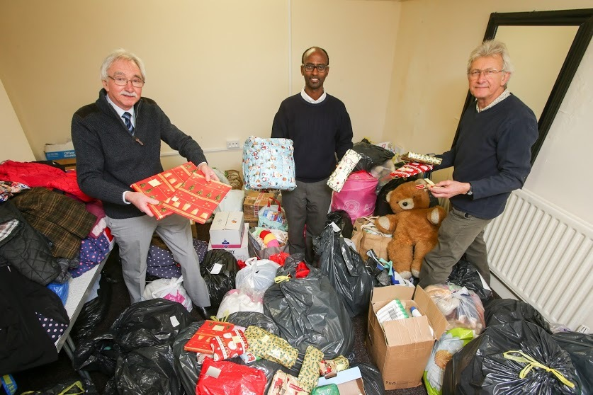 Chris watts from the 2 Dales Action for Refugees, Bini Araia and Pete Widlinski with presents for people seeking asylum, refugees and their families living in Teesside. Picture: TOM BANKS