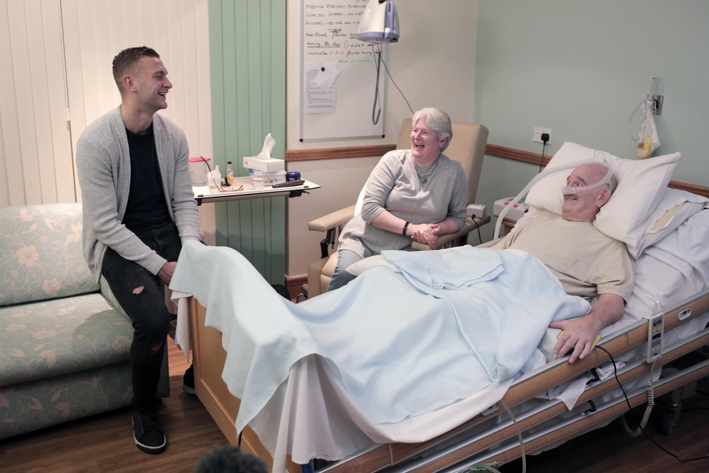 Ben Gibson at Teesside Hospice in Middlesbrough with patient Craig Beer and his wife Lesley