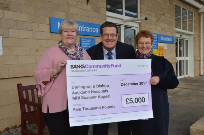 DONATION: Pat Chambers, left, and Jenny Flynn, right, of the County Durham & Darlington NHS Foundation Trust Charity with Mark Dowdall of The Banks Group