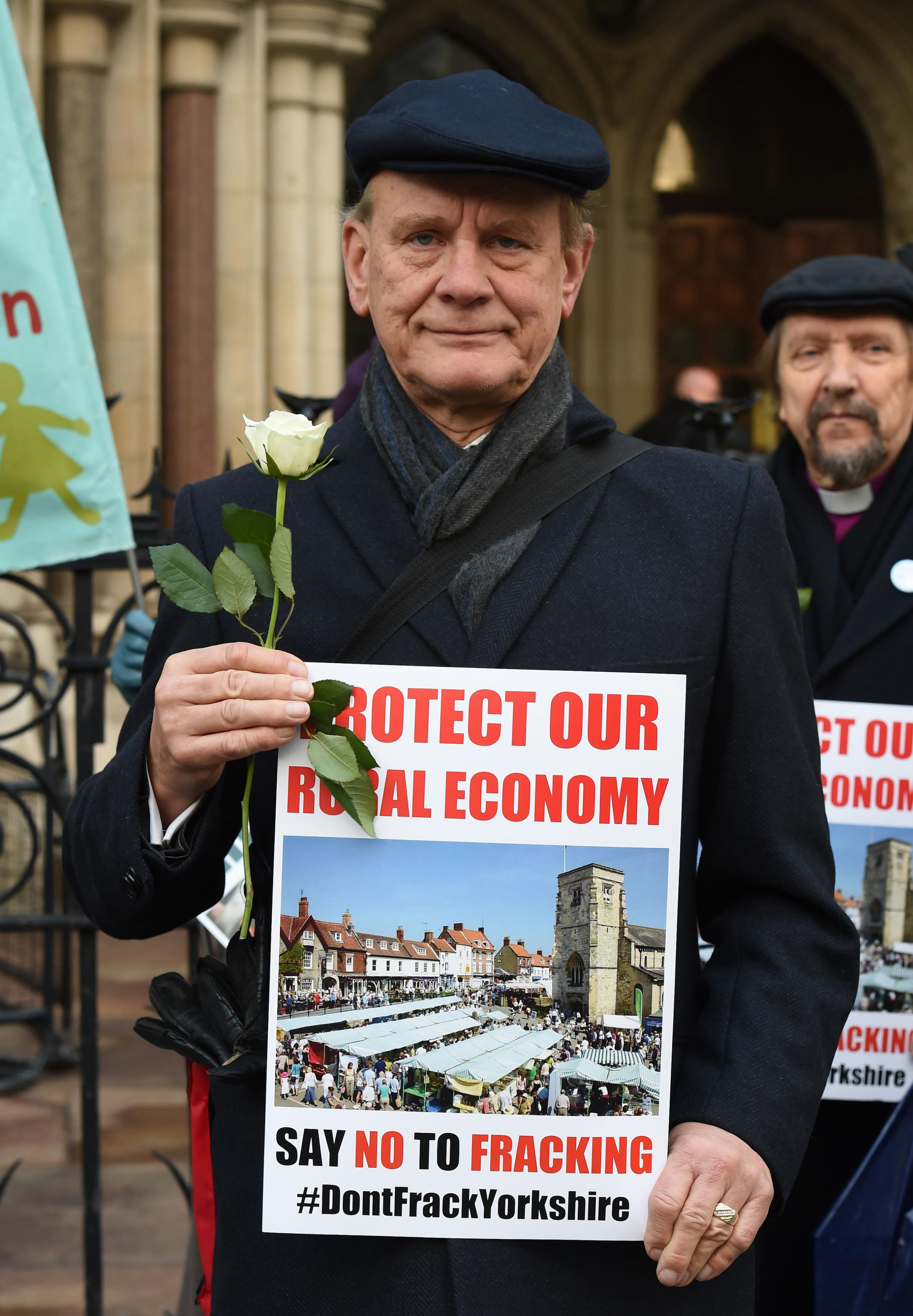 Ryedale district councillor Paul Andrews joins residents of Kirby Misperton and campaigners outside the Royal Courts of Justice in London, where they are challenging one of the first planning applications to carry out fracking. PRESS ASSOCIATION