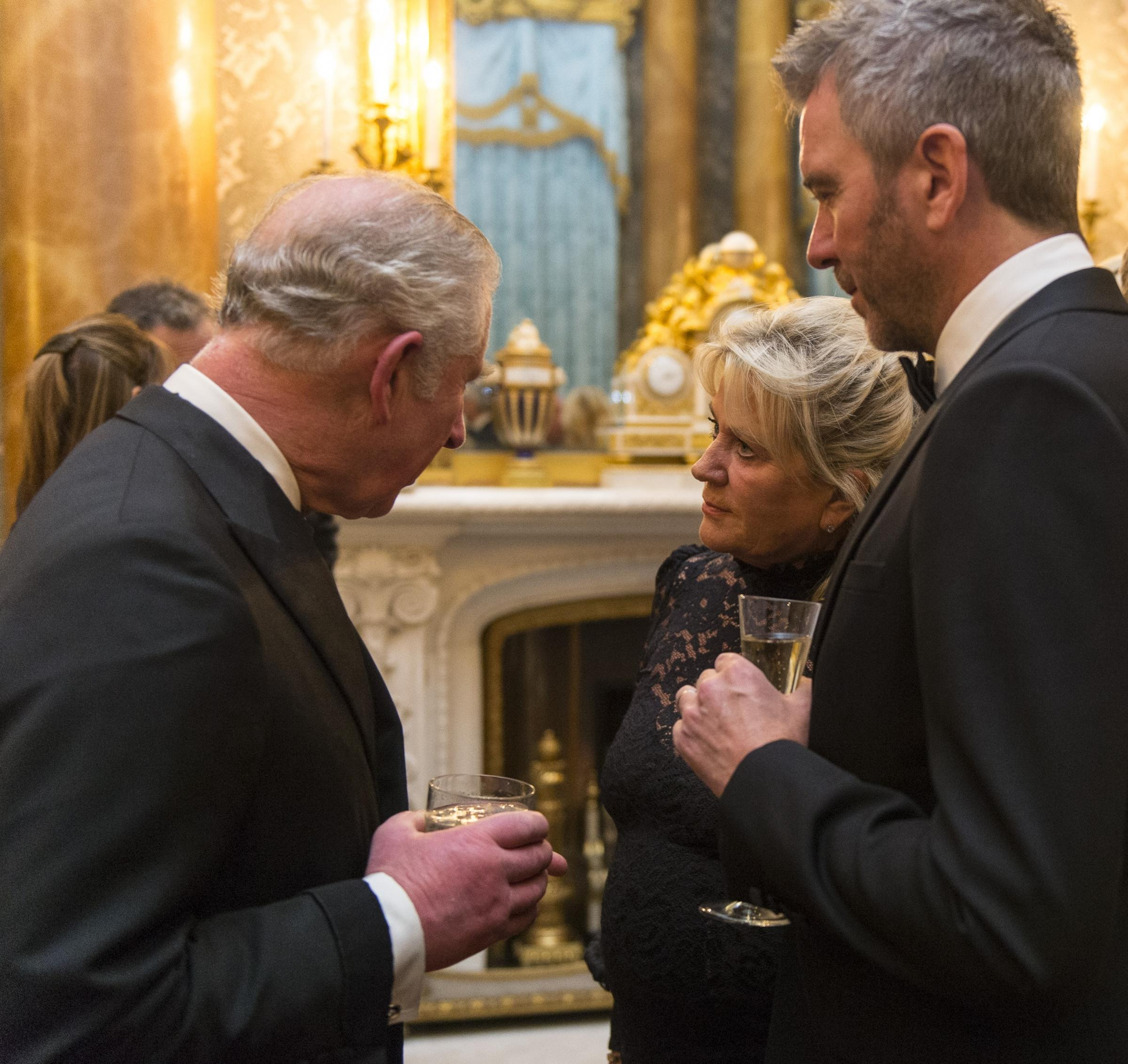 Helen McCardle and her son Mark meeting the Prince Charles during the Prince's Trust dinner at Buckingham Palace