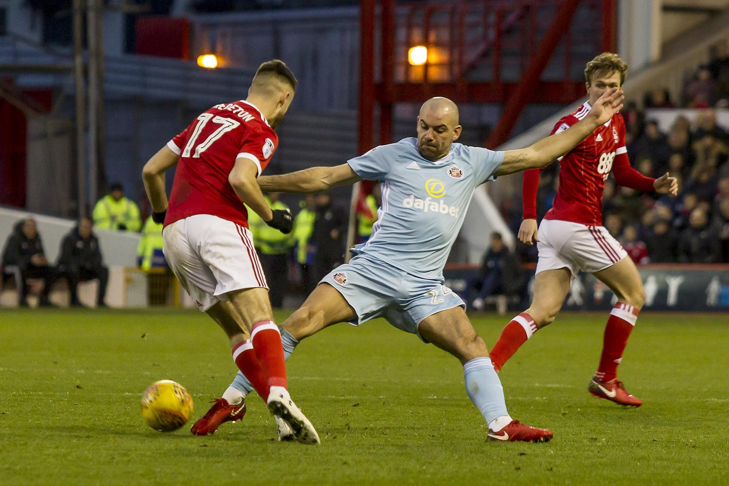 TOP MAN: Darron Gibson was at the hub of Sunderland again and he tackled Ben Brereton here.