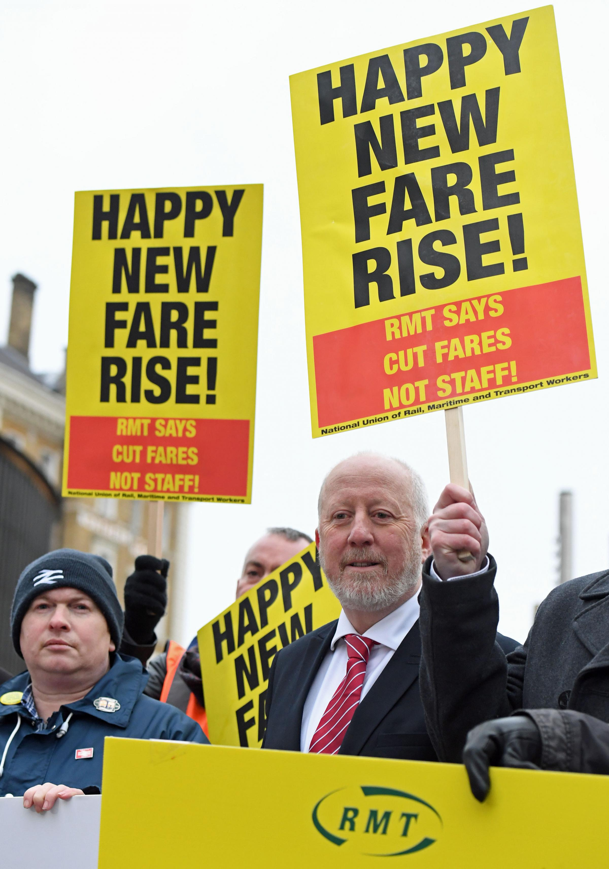 Shadow Transport Secretary Andy McDonald (centre) joins campaigners protesting against rail fare increases outside King's Cross station in London. Picture: PA