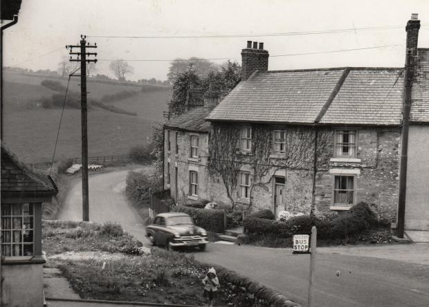 "The Northern Echo: REDWORTH CLEARANCE: This is looking north on the A6072 towards Shildon on May 10, 1960. On the back of the picture someone has written ""bad corner at Redworth which is to be improved"". All the buildings in the picture were cleared a part from th"