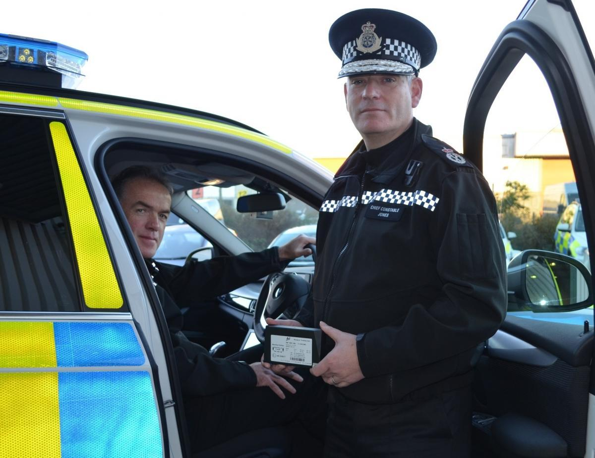 DELAYED: Assistant Chief Constable Paul Kennedy and Chief Constable Dave Jones with one of the first vehicles to be fitted with a new black box in 2015.