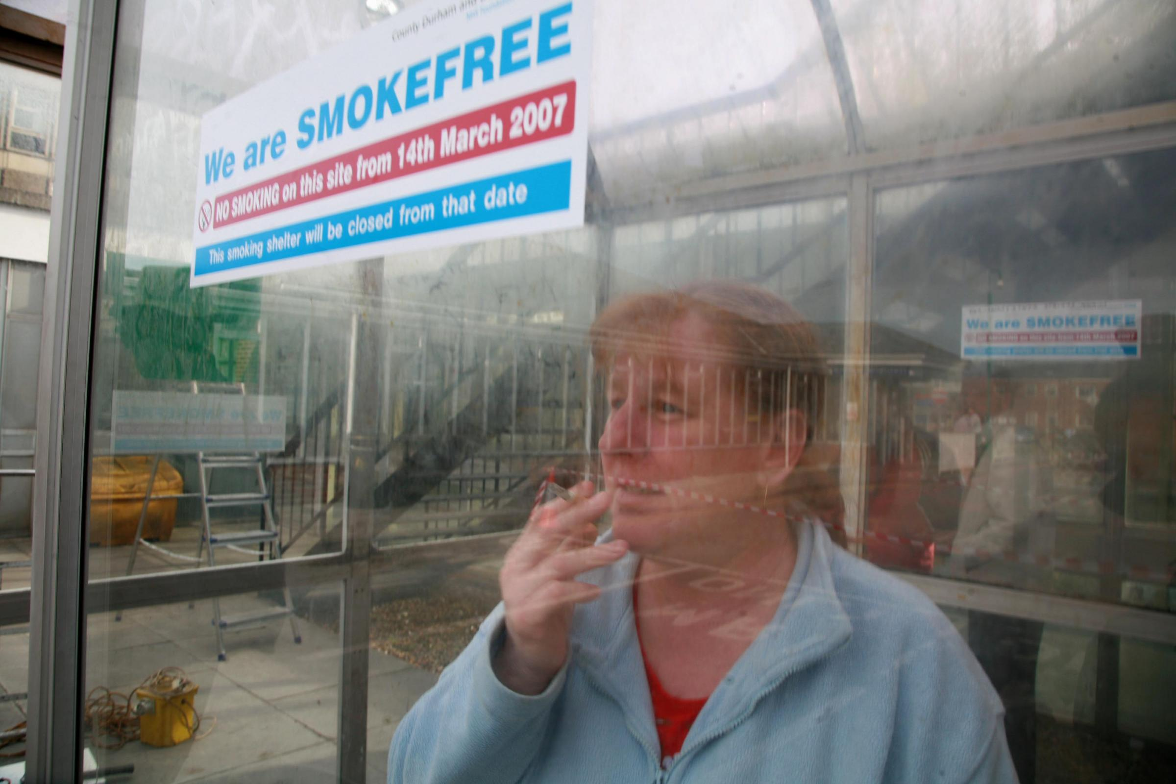 GONE: Andrea Edward takes a last drag in a smoking shelter at Darlington Memorial Hospital before it was removed in 2007