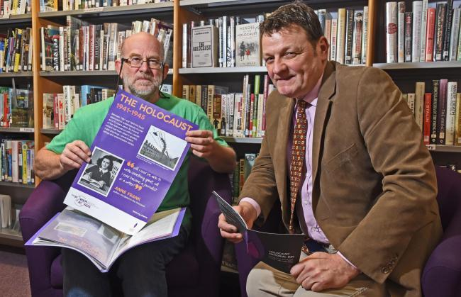REMEMBER: Volunteer Ian Ferguson, left, and Cllr Greg White, executive member for libraries, preparing at Pickering library. Picture: Nigel Holland.