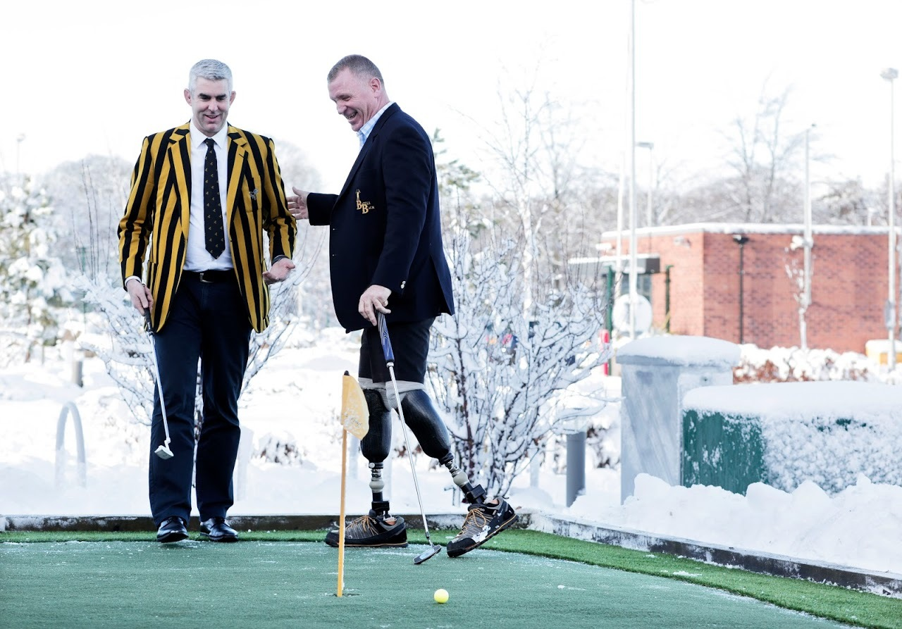 GOLF: From left, former Wasps rugby player Peter Scrivener and Invictus Games UK team captain Bernie Broad Picture: STUART BOULTON