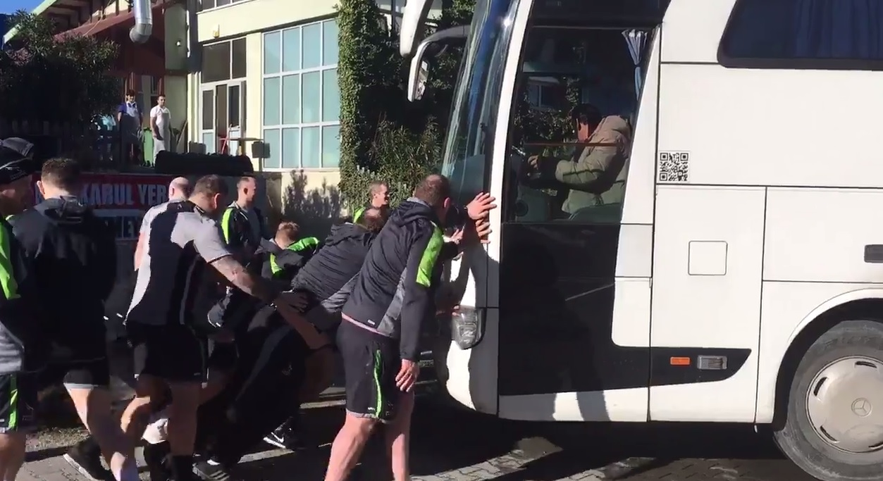 GOING NOWHERE: Newcastle Falcons' players try to move their team bus after it became stuck in a ditch in Turkey (Picture: Newcastle Falcons Twitter)