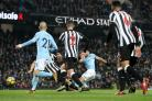 TREBLE TIME: Sergio Aguero completes his hat-trick in Manchester City's 3-1 win over Newcastle (Picture: Martin Rickett/PA Wire)