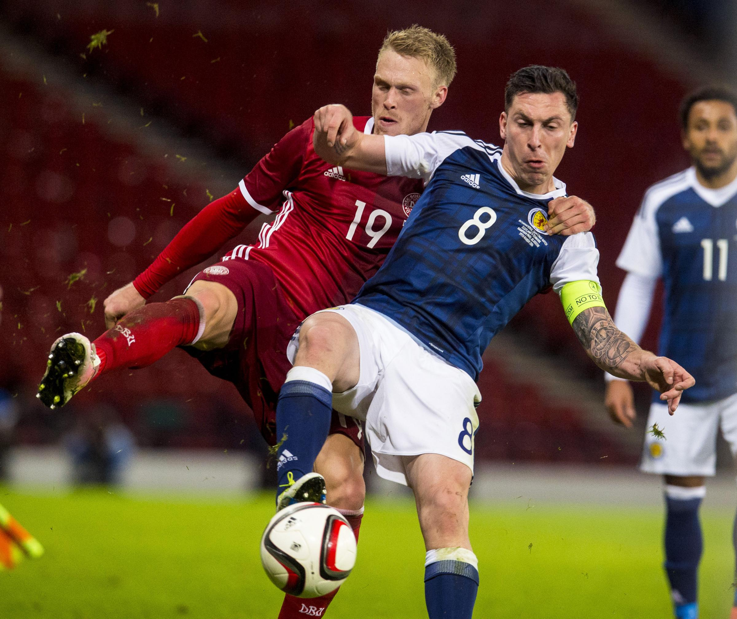 TRANSFER TARGET: Newcastle are hoping to sign Denmark international Nicolai Jorgensen, pictured battling for possession with Scotland's Scott Brown