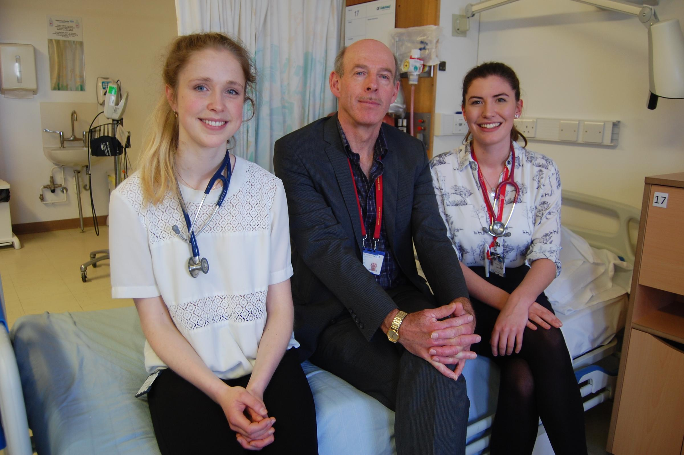 CARE: Clive Kelly, centre, a consultant in acute medicine at the Queen Elizabeth Hospital in Gateshead, with medical students, Lauren McAnallen, left, and Caitlin Brown. Picture by GAVIN HAVERY