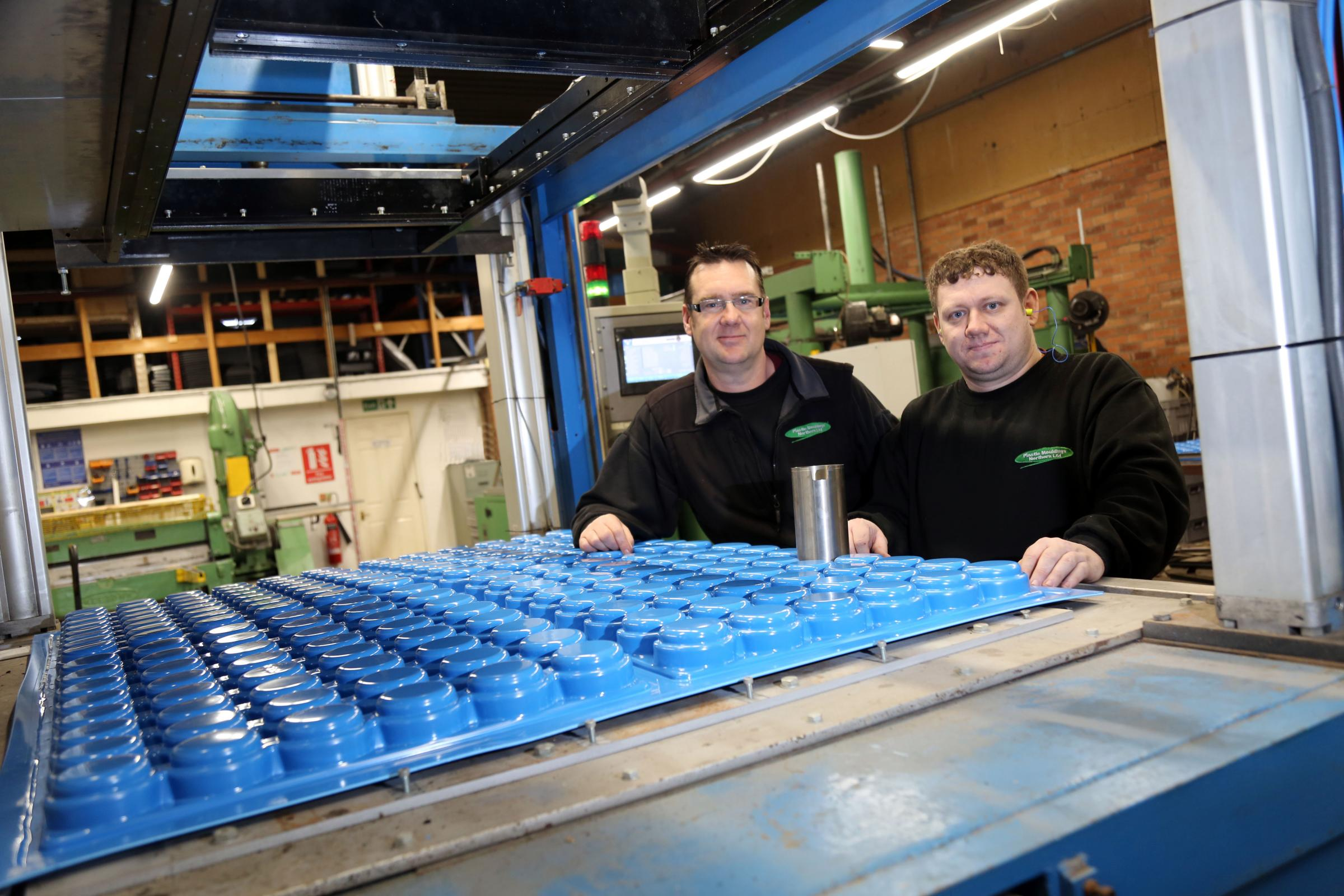 INVESTMENT: Plastic Mouldings Northern's production director Mark Rigg with team leader Andrew Stanley and the company's new machine