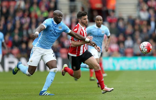Southampton's Shane Long (right) and Manchester City's Eliaquim Mangala battle for the ball during the Barclays Premier League match at St Marys, Southampton. PRESS ASSOCIATION Photo. Picture date: Sunday May 1, 2016. See PA story SOCCER Southampt