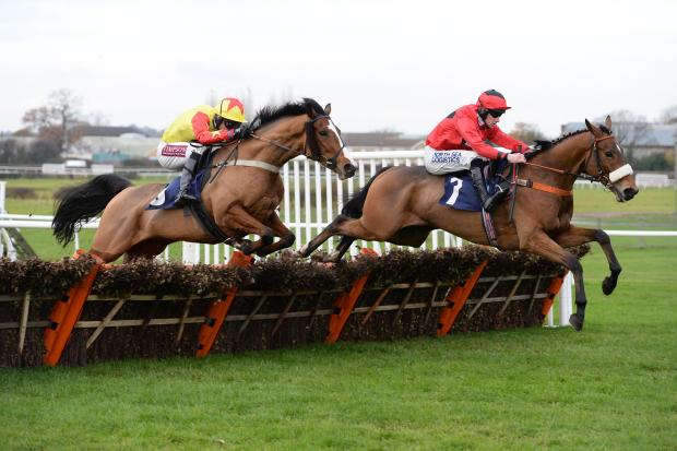 The Northern Echo: WINNER: Another of Malcolm Jefferson's horses, Robbing The Prey, ridden by Brian Hughes leading over flight of hurdles at Wetherby Racecourse