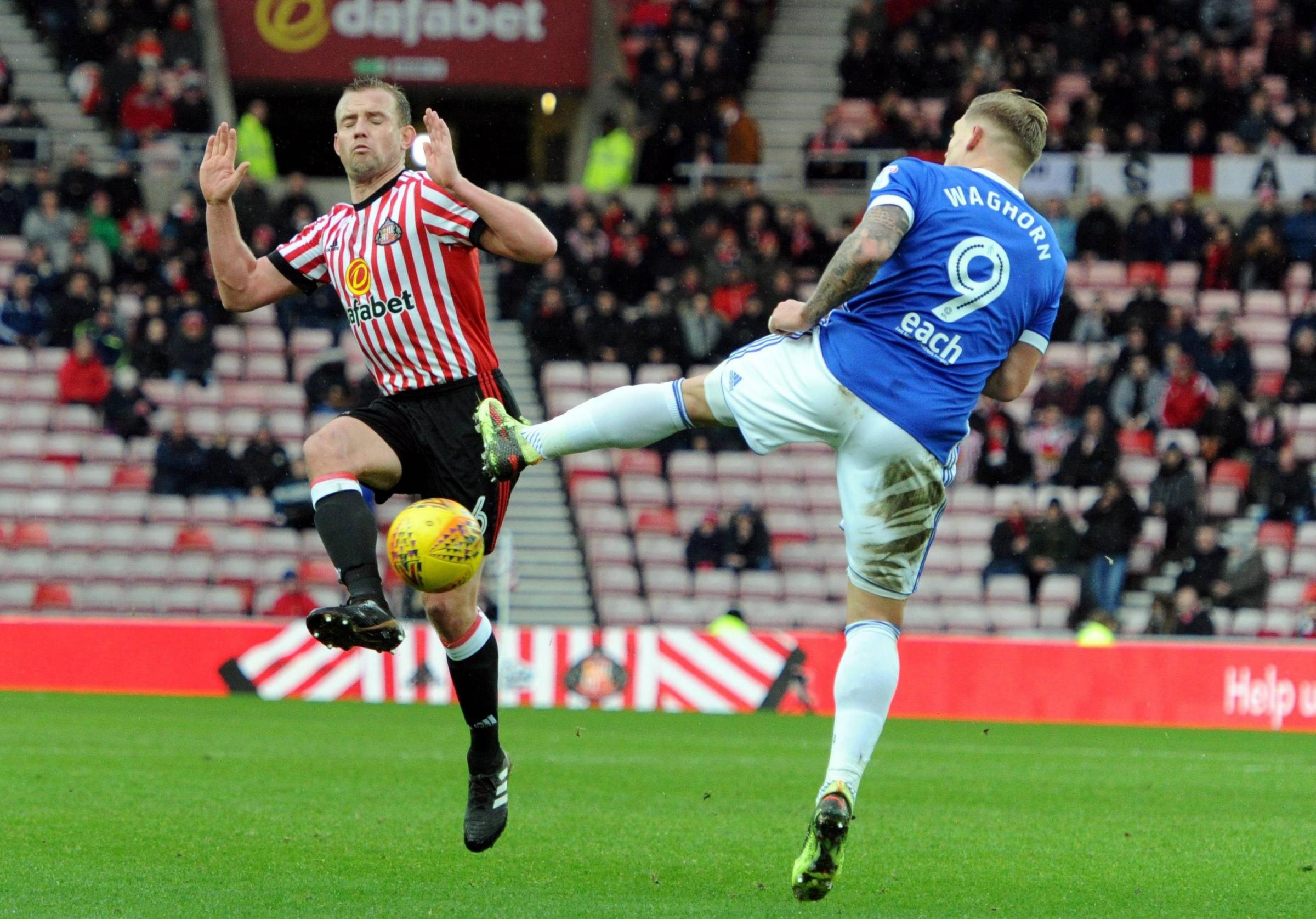 MY BALL: Lee Cattermole challenges Ipswich forward Martyn Waghorn for possession (Picture: North News)
