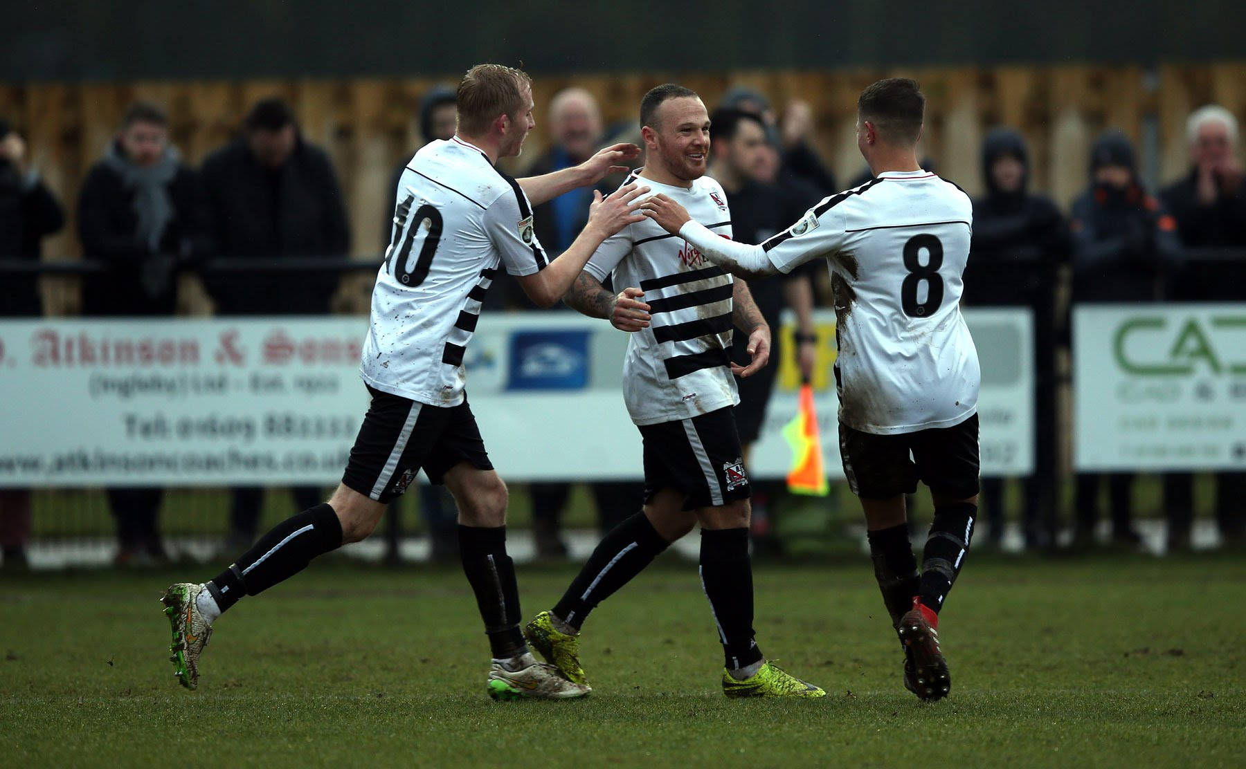 ONE NIL: Stephen Thompson (centre) after putting Darlington ahead with a penalty. Picture: CHRIS BOOTH