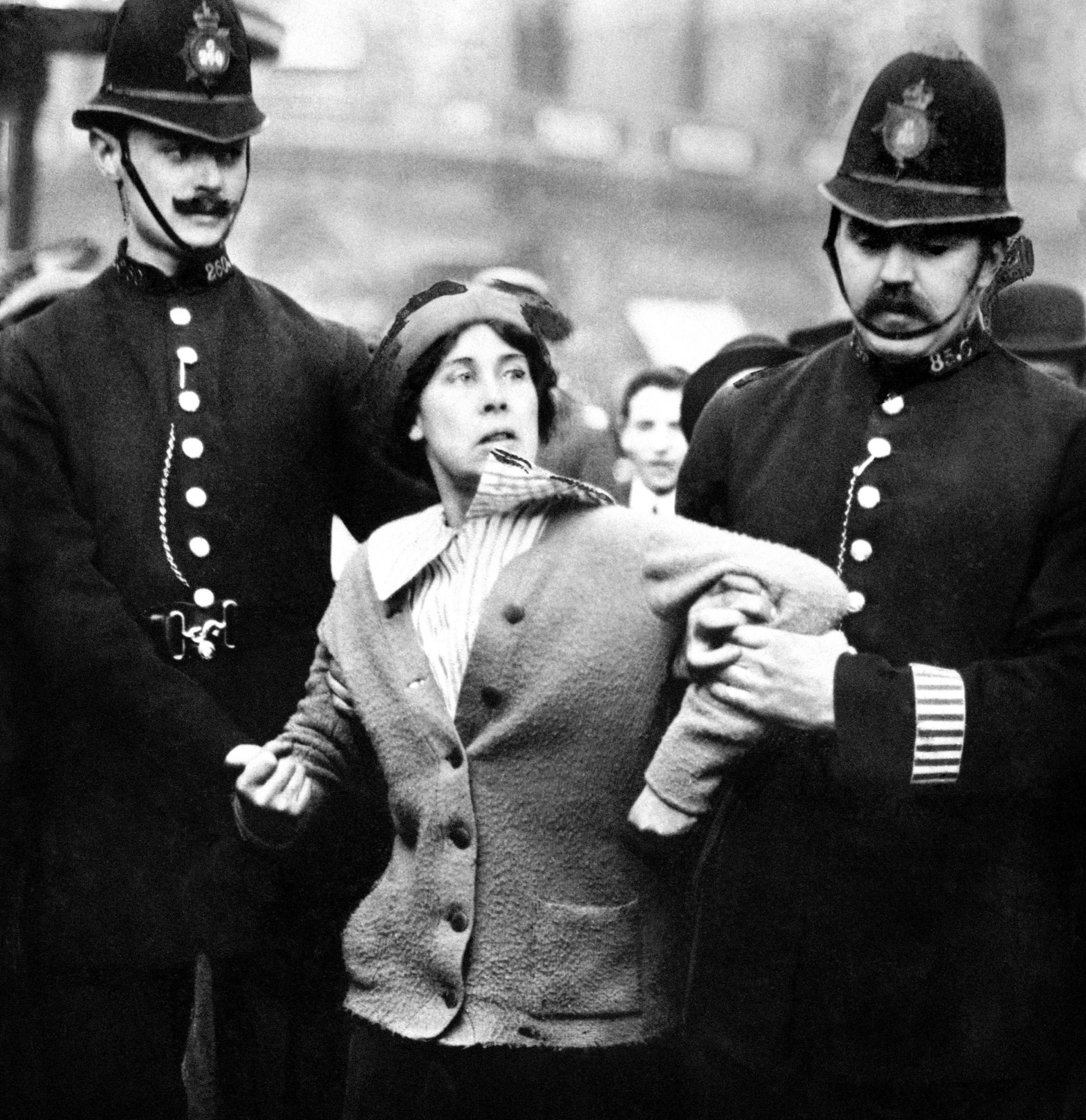 EQUALITY?: A suffragette being arrested by police officers in 1914 Picture: PA