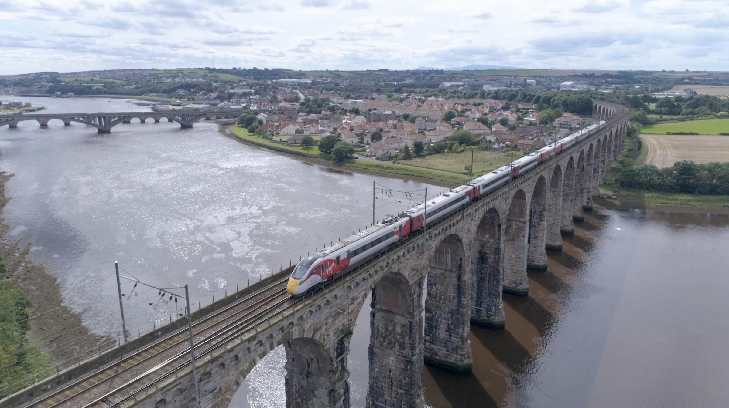 TIMETABLE: Hitachi Rail Europe says issues over the operation of the East Coast Mainline franchise won't affect its manufacturing agreement. Pictured is one of the firm's Azuma trains crossing Berwick's Royal Border Bridge during testing last year