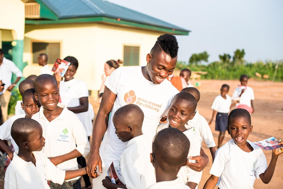 IN AFRICA: Christian Atsu, pictured during a visit to Ghana in his role as an ambassador for the charity Arms Around The Child (Pictures: Arms Around The Child)