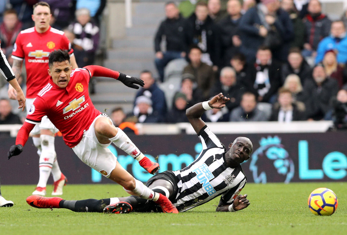 MY BALL: Mo Diame battles with Alexis Sanchez during Newcastle's 1-0 win over Manchester United (Picture: Owen Humphreys/PA Wire)