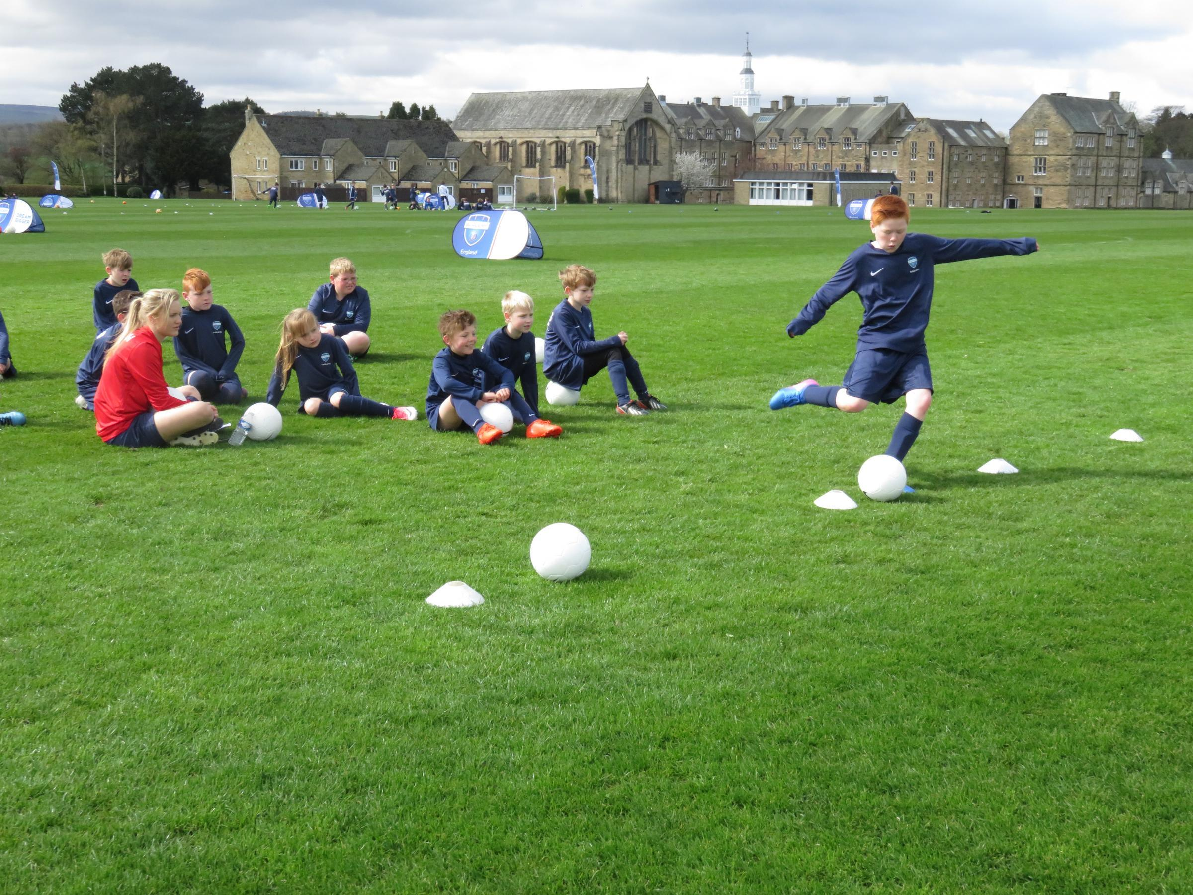Youngsters take part in a PSG soccer camp at Barnard Castle School