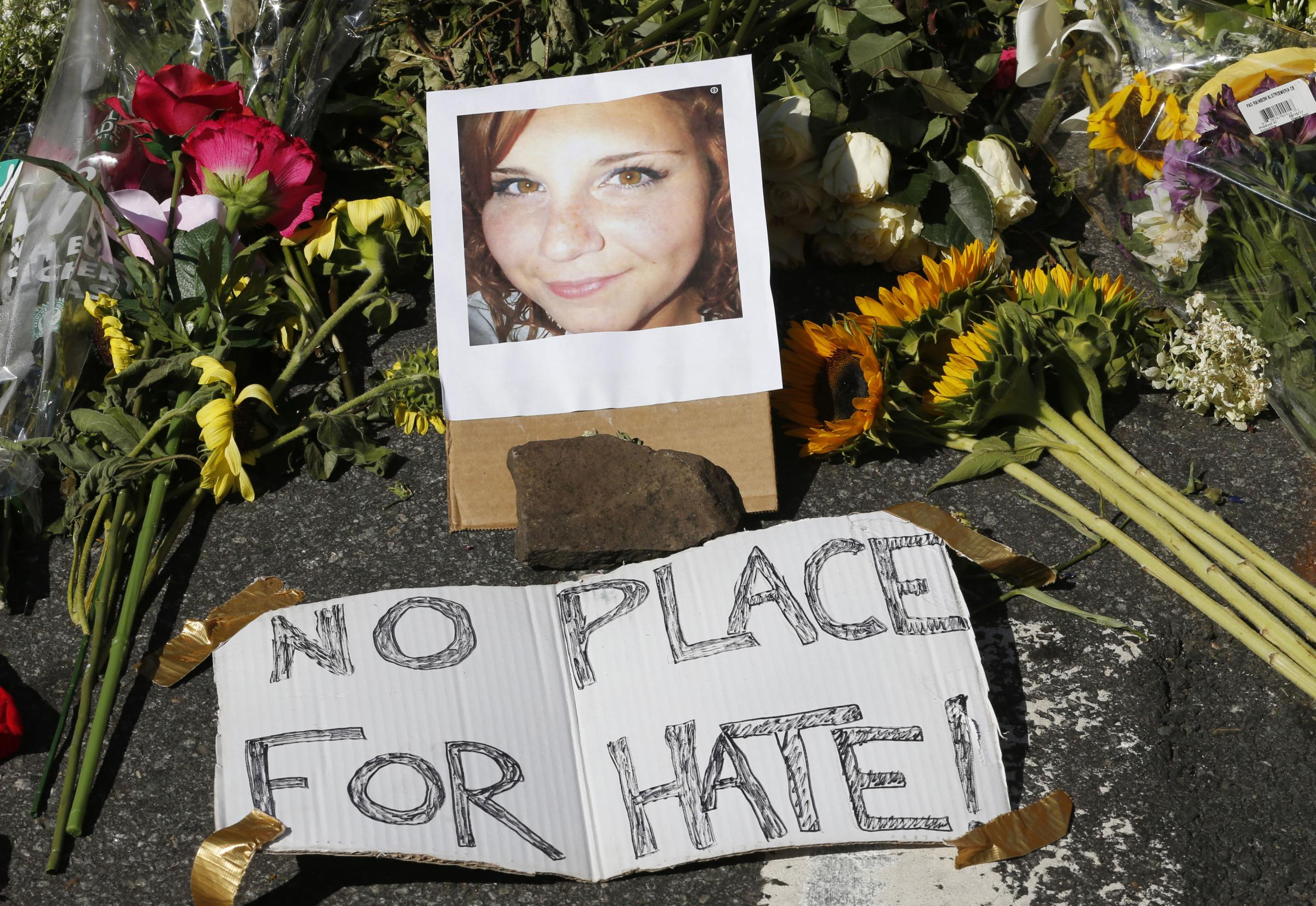 TRIBUTE: A makeshift memorial of flowers and a photo Heather Heyer, who died while protesting against a white supremacist rally in Charlottesville, Virginia, last year Picture: AP/STEVE HELBER