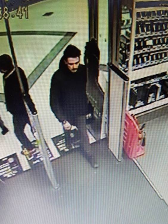 The suspected shoplifter was seen inside the Games Store, in Darlington's Cornmill Shopping Centre. Picture: DURHAM POLICE