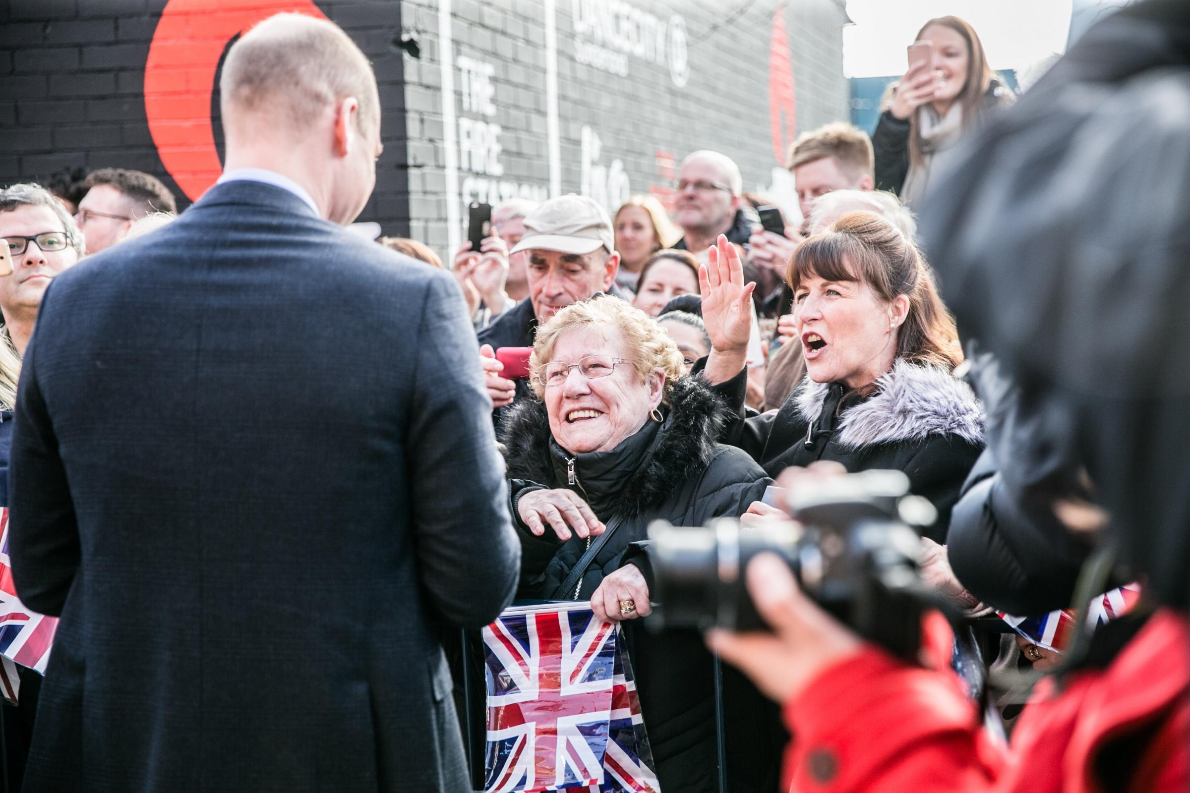Speaking with a woman who had waited to meet the Royal couple Prince William was directed towards another spectator who told him she was a midwife. Picture: SARAH CALDECOTT