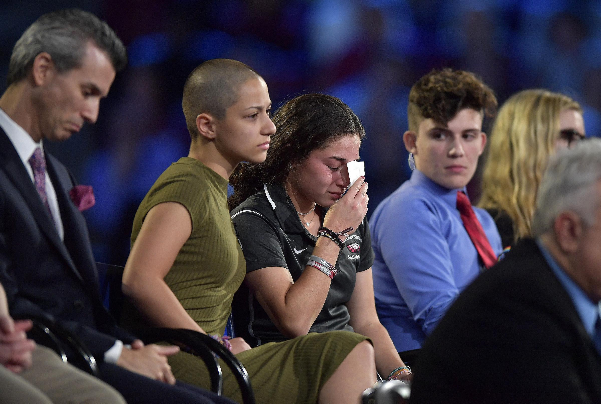 Marjory Stoneman Douglas High School student Emma Gonzalez comforts a classmate during a CNN town hall meeting Picture: AP