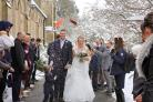 MARRIED: Guests formed a guard of honour with snow shovels and threw confetti. Picture: SARAH THEW PHOTOGRAPHY