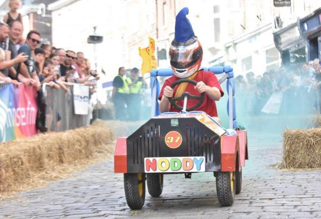 LAUGHS: A driver in the Micklegate Run Soapbox Challenge Picture: FRANK DWYER