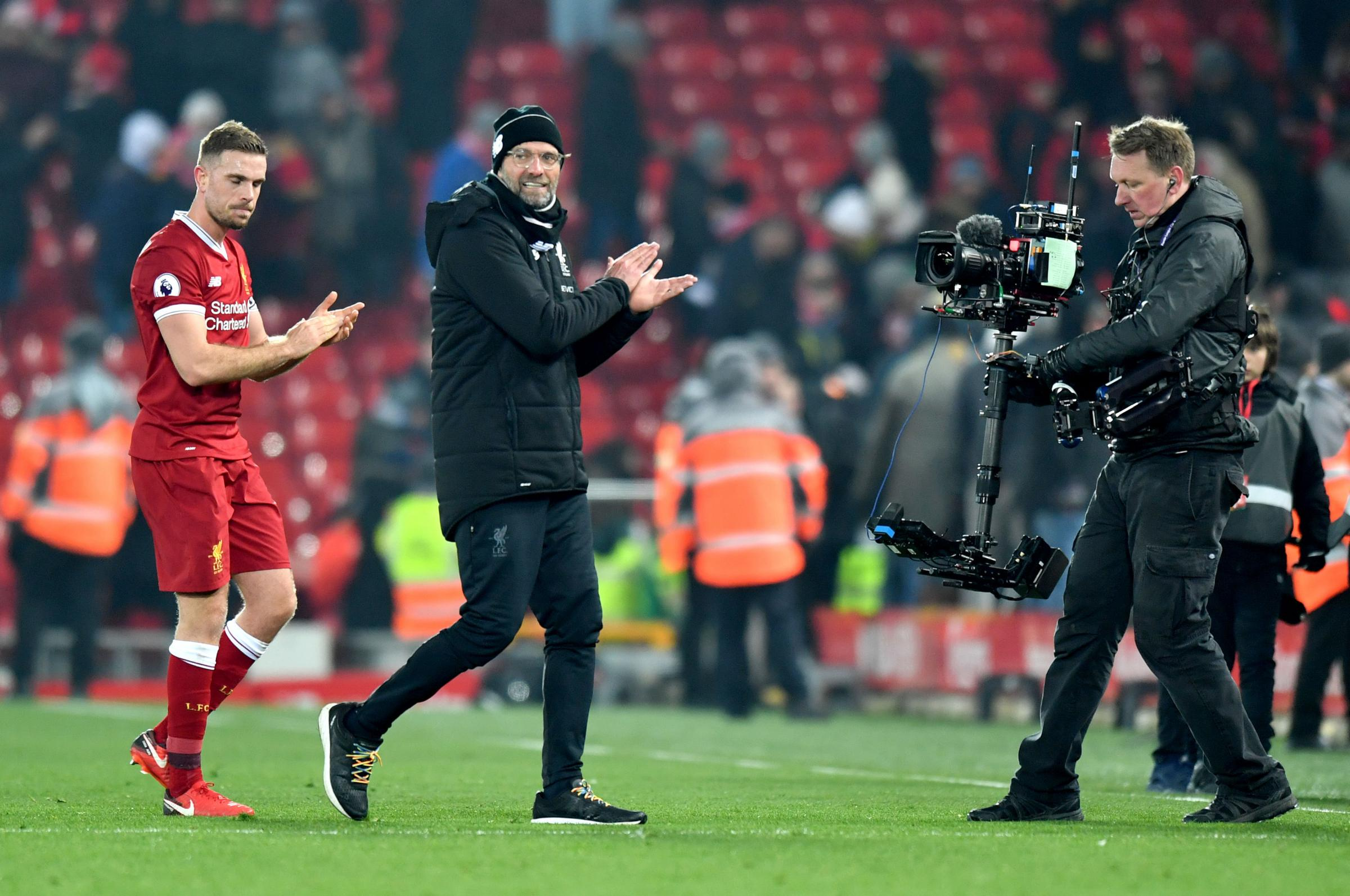 TOP MARKS: Liverpool manager Jurgen Klopp walks off after the final whistle with man of the match Jordan Henderson