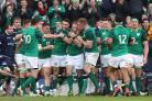 Ireland celebrate Sean Cronin's bonus-point clinching try against Scotland (Brian Lawless/PA)