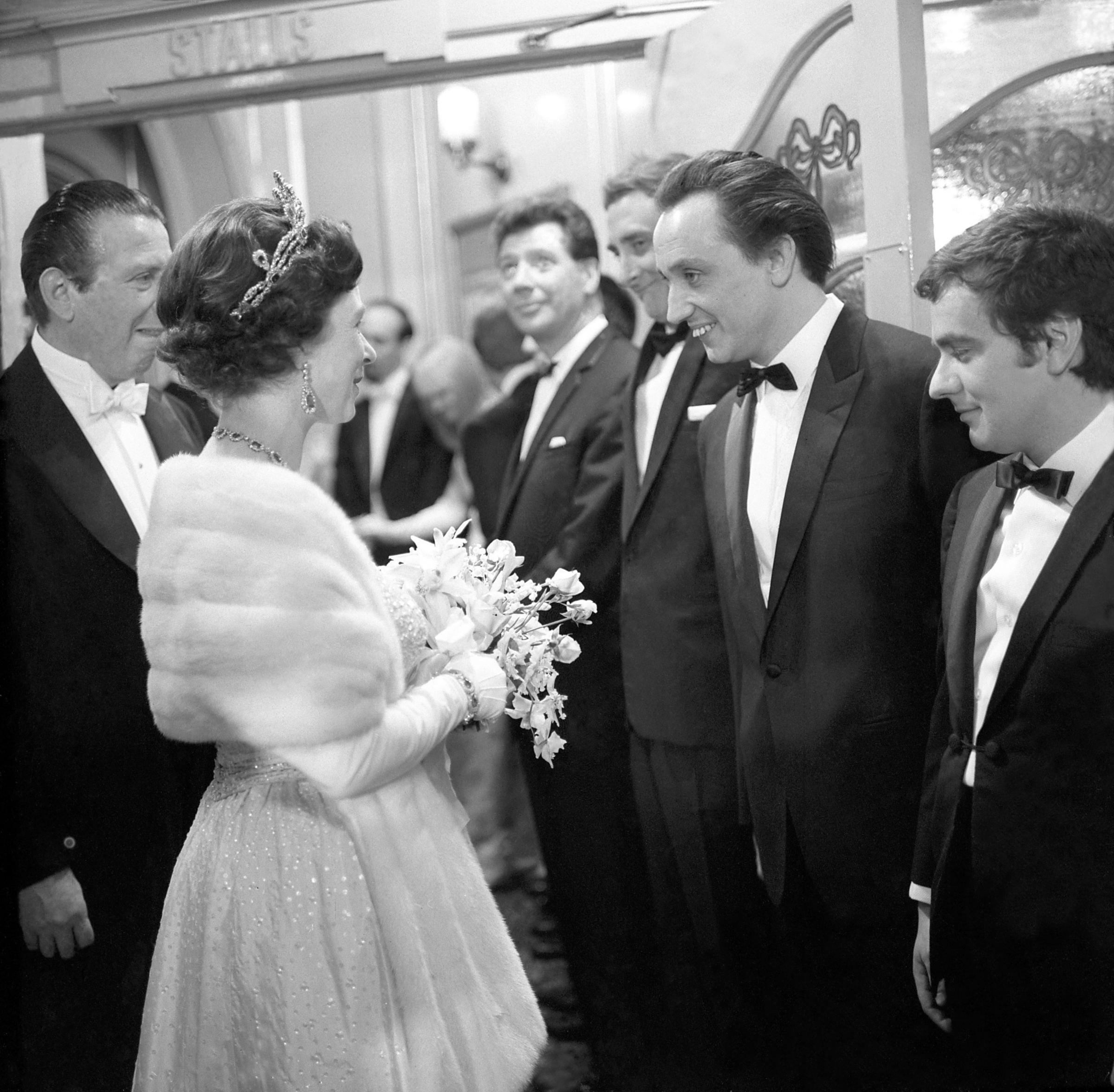 Queen Elizabeth II talks with Liverpool comedian Ken Dodd when the stars were presented at the Royal Variety Performance at the London Palladium. At left are Max Bygraves, Spike Milligan and Dudley Moore. File photo dated 09/11/1965 showing Sir Ken Dodd,