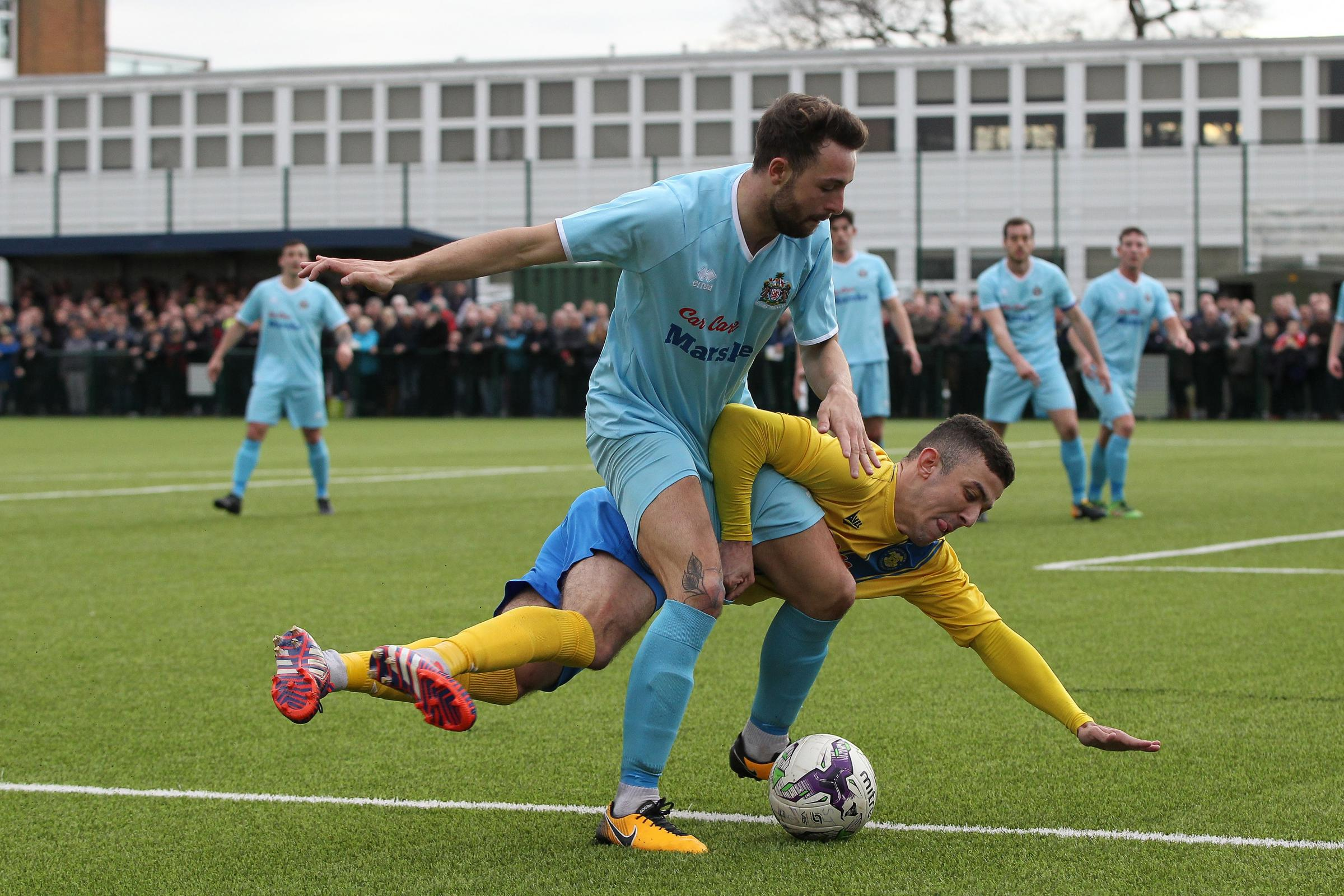Stockton's James Risborough battles with Marske's James Fairley during the The Buildbase FA Vase match between Stockton Town and Marske United at Bishopton Road West, Stockton on Tees on Saturday 24th March 2018. (Credit: Mark Fletcher)