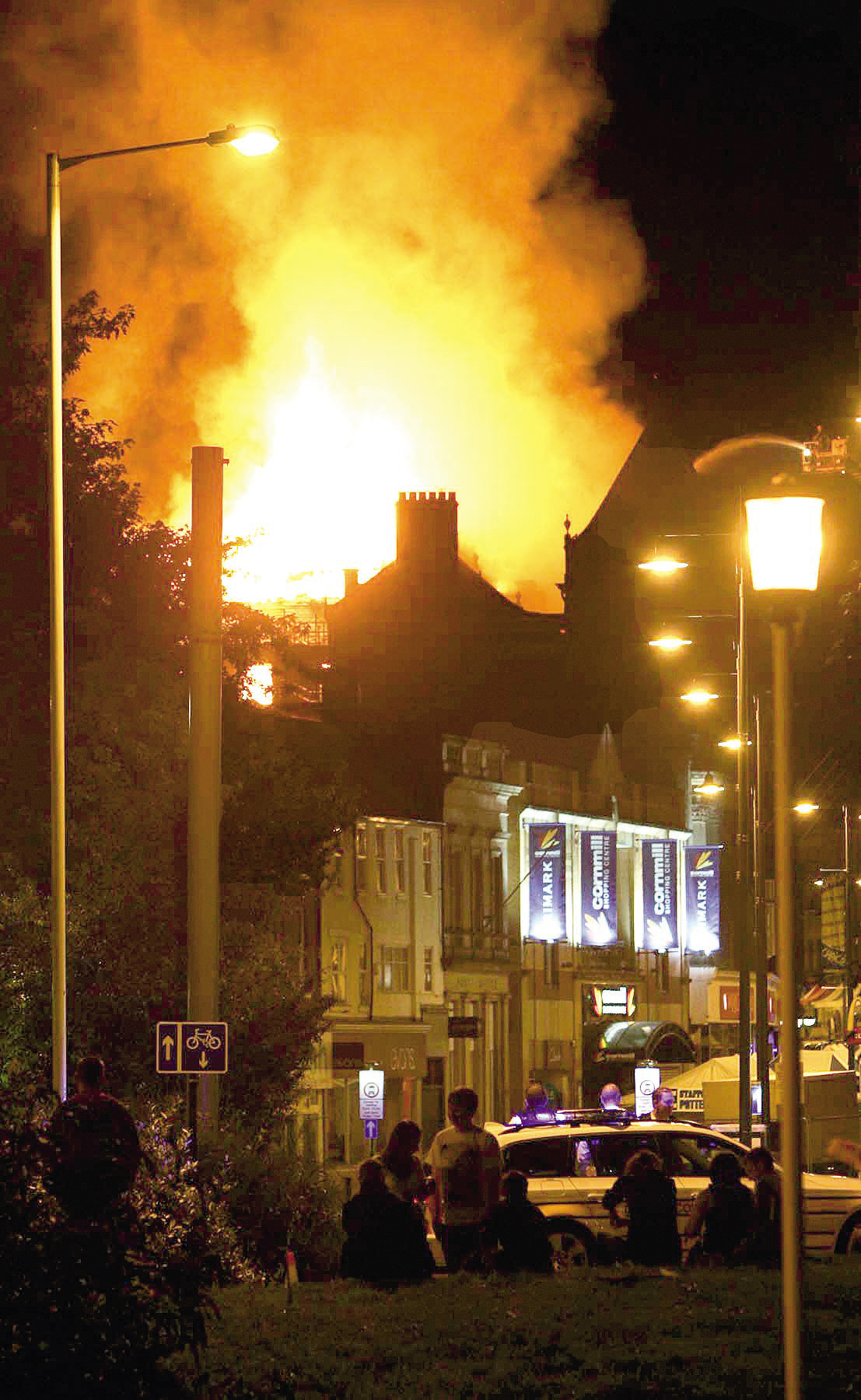 People watch the fire at the King 's Hotel, in Darlington, on 15 August, 2008