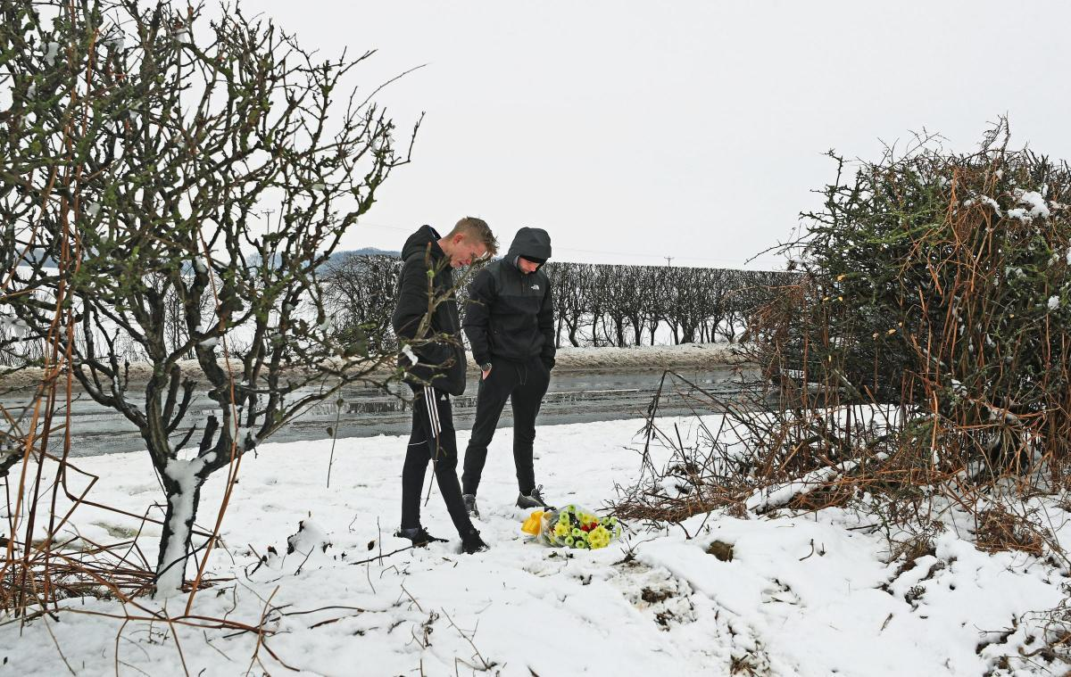 Visitors to the crash site where tributes were laid to Mason Pearson and George Turner Picture: PA