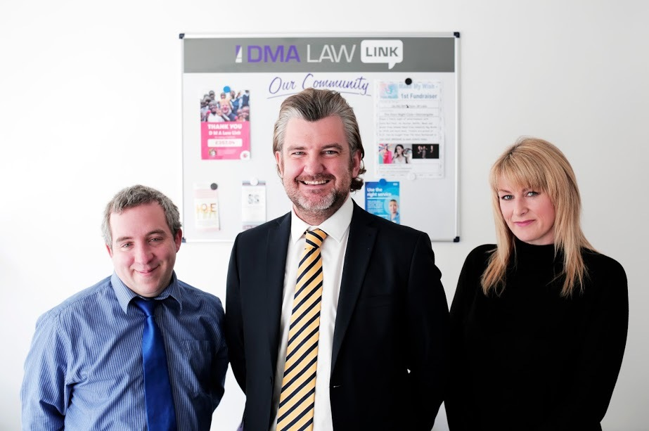 BIRTHDAY: Lawyer Gavin Lucas with his team Chris Cox and Claire Plews at the DMA Law offices on Darlington's Skinnergate Picture: STUART BOULTON