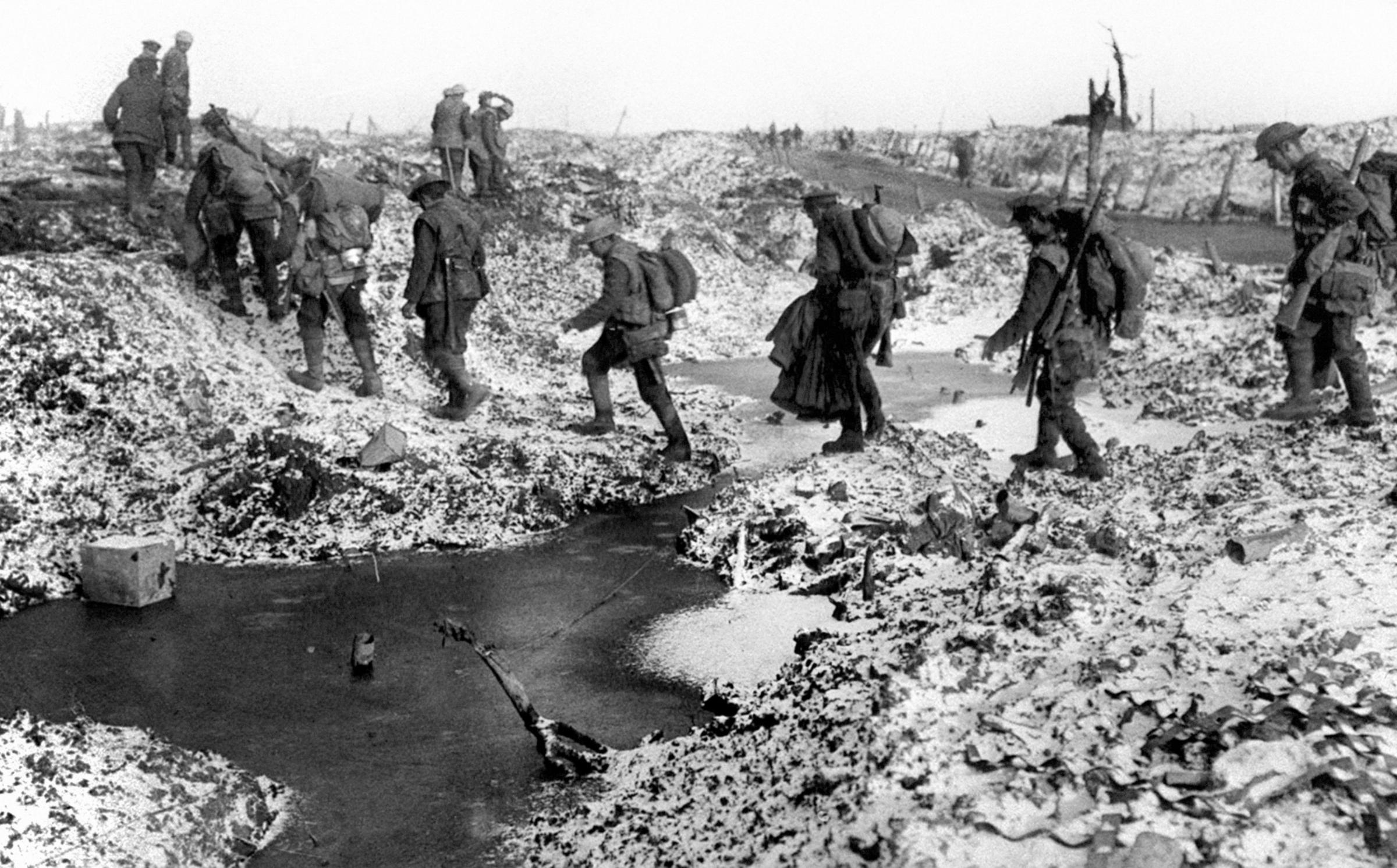 British soldiers negotiating a shell-cratered, winter landscape along the River Somme in late 1916 after the close of the Allied offensive. Picture: PA Wire