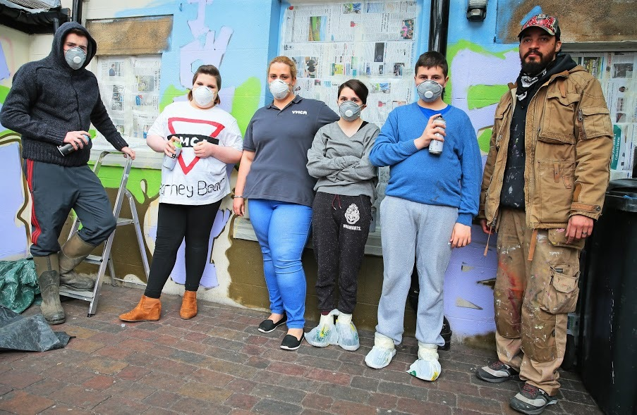 ART: Teesdale YMCA have been taking part in a community art project to spruce up the YMCA building outside, pictured Tom Redpath, Rebecca Walker, Rebecca Pearson, Katie Neill, Reece Allan and artist Graham Cleland Picture: SARAH CALDECOTT.