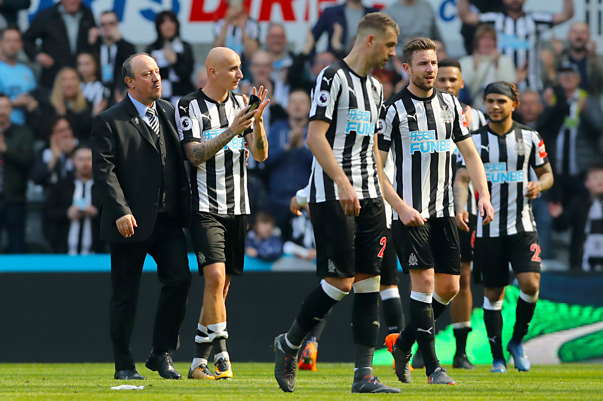 ALL SMILES: Rafael Benitez celebrates with his Newcastle players in the wake of today's 2-1 win over Arsenal (Picture: Owen Humphreys/PA Wire)