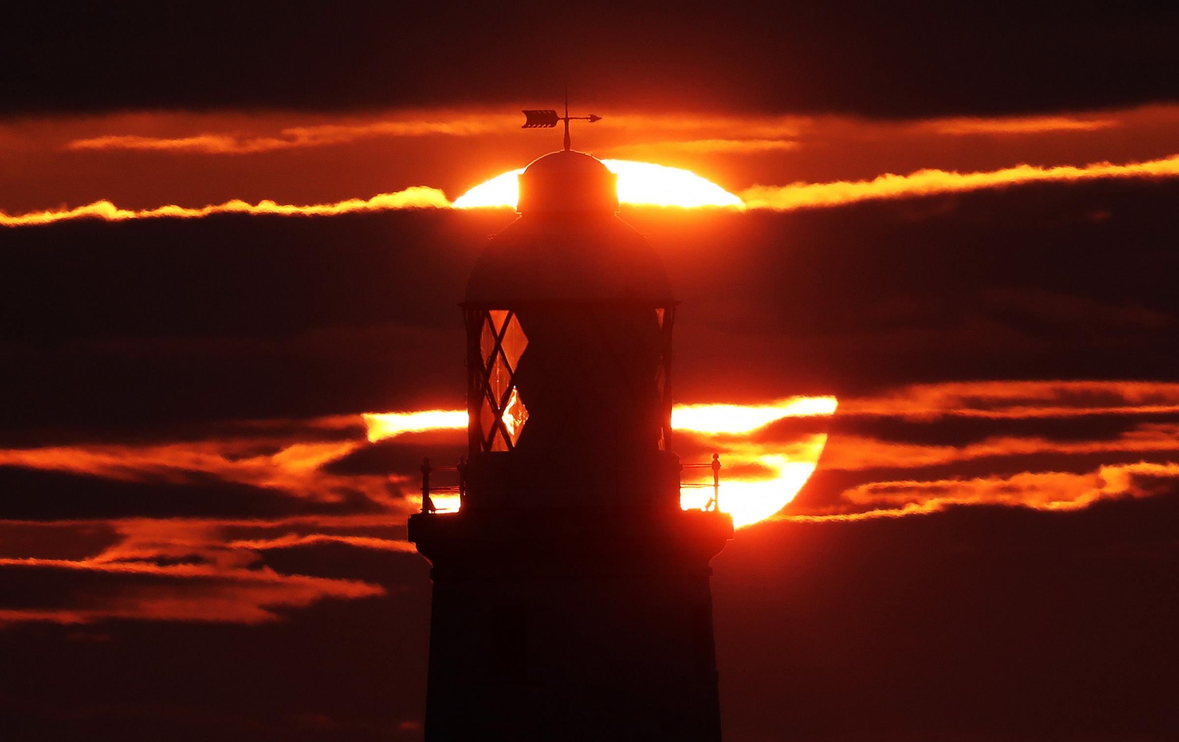 Sunrise at St Mary's Lighthouse in Whitley Bay, Northumberland. Picture: PA
