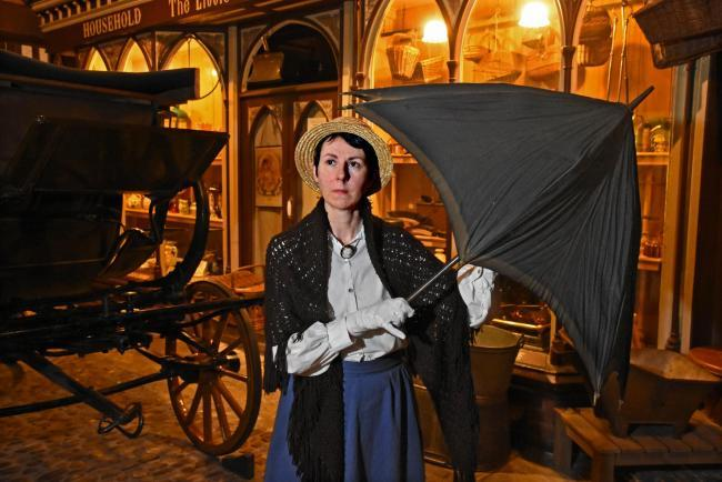 BROLLY: The museum's retail visitor assistant Maria Smith with York's first umbrella dated 1837 at the Castle Museum.Pic Nigel Holland.