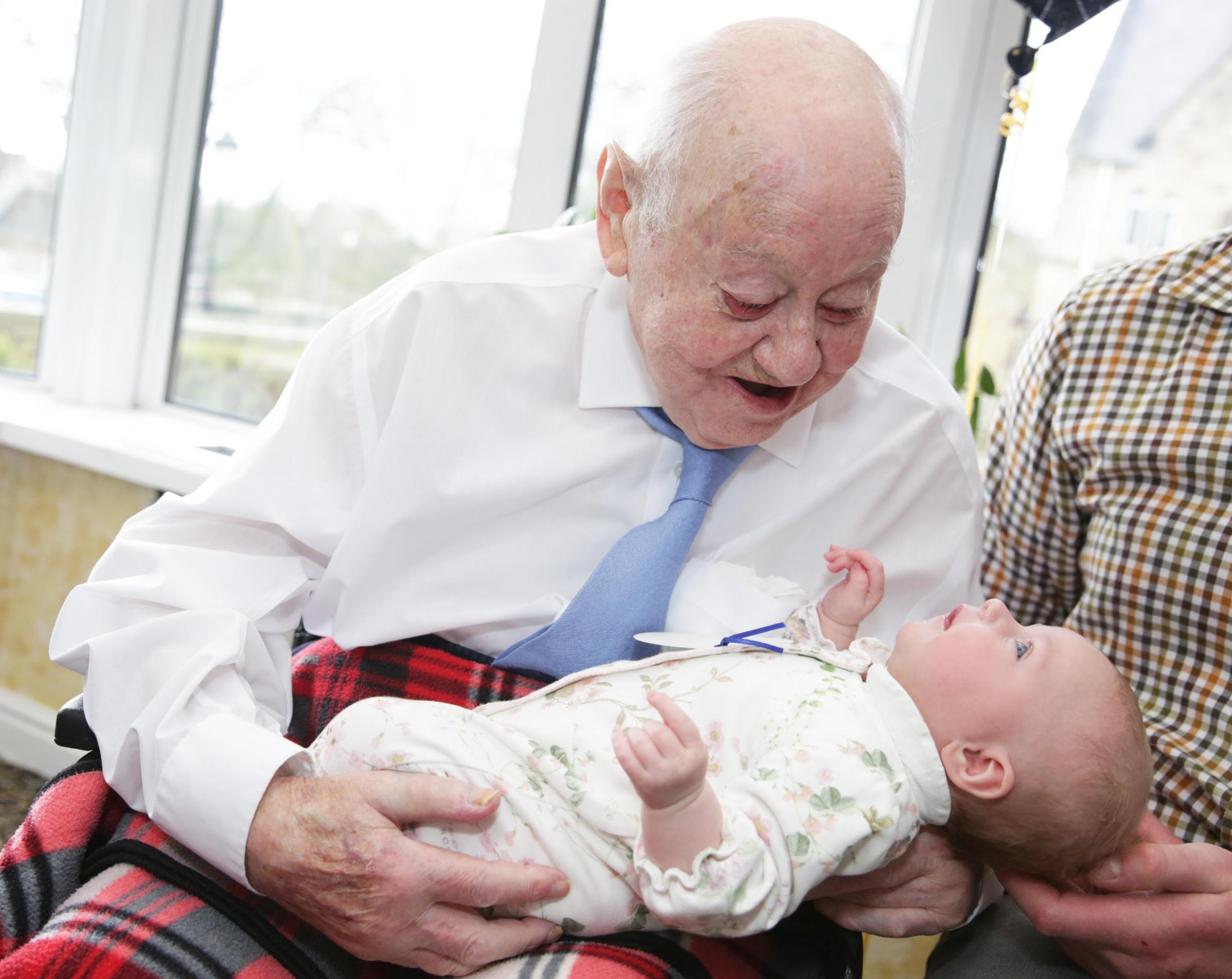 CELEBRATIONS: Alfred Moody, who used to run Moody's in Durham, is celebrating his 100th birthday at Sherburn House care home he is pictured with hiss great granddaughter Harriot Chrystal 8 weeks Picture: SARAH CALDECOTT