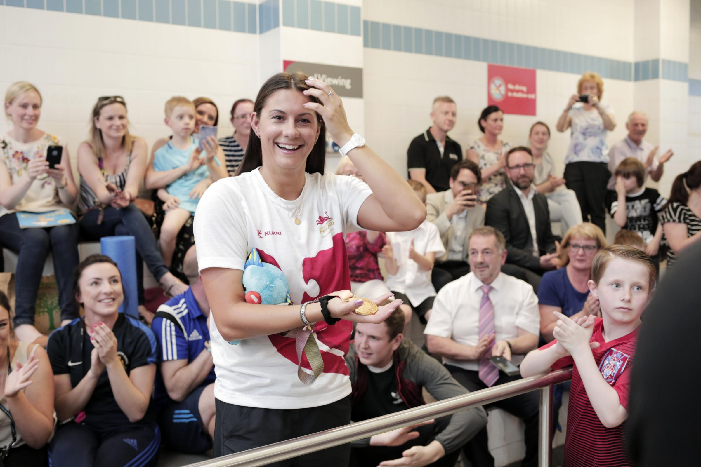 Commonwealth gold medallist Aimee Willmott is greeted by friends on her arrival at the Neptune Leisure Centre in Middlesbrough. Photograph: Stuart Boulton.