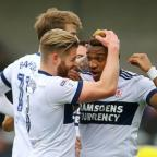 The Northern Echo: FORM? Britt Assombalonga celebrates scoring at Burton with Adam Clayton and Patrick Bamford