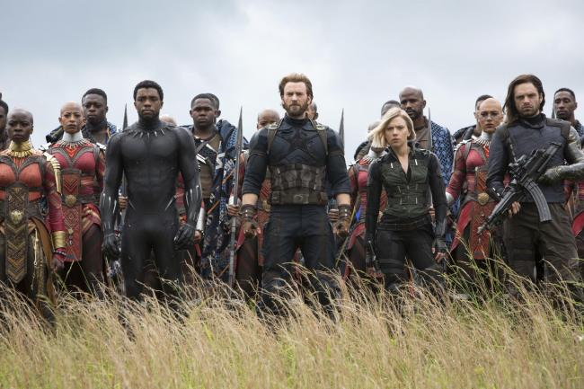 This image released by Marvel Studios shows, front row from left, Danai Gurira, Chadwick Boseman, Chris Evans, Scarlet Johansson and Sebastian Stan in a scene from